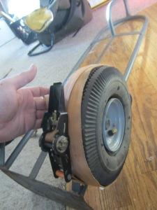Wrap ratcheting strap around tire